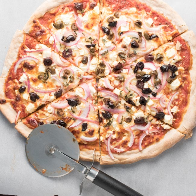 Greek Pizza - red onions, feta cheese, kalamata olives, oregano, and sauce