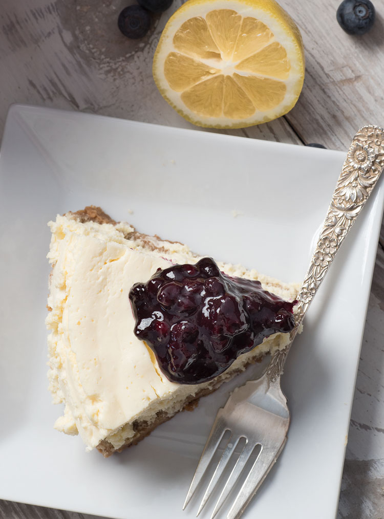 instant pot cheesecake with homemade blueberry sauce and graham cracker crust