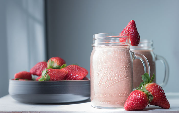 vegan strawberry and chocolate (cacao) smoothies made with almond milk and frozen bananas