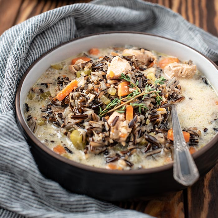 bowl of instant pot chicken soup with wild rice and vegetables