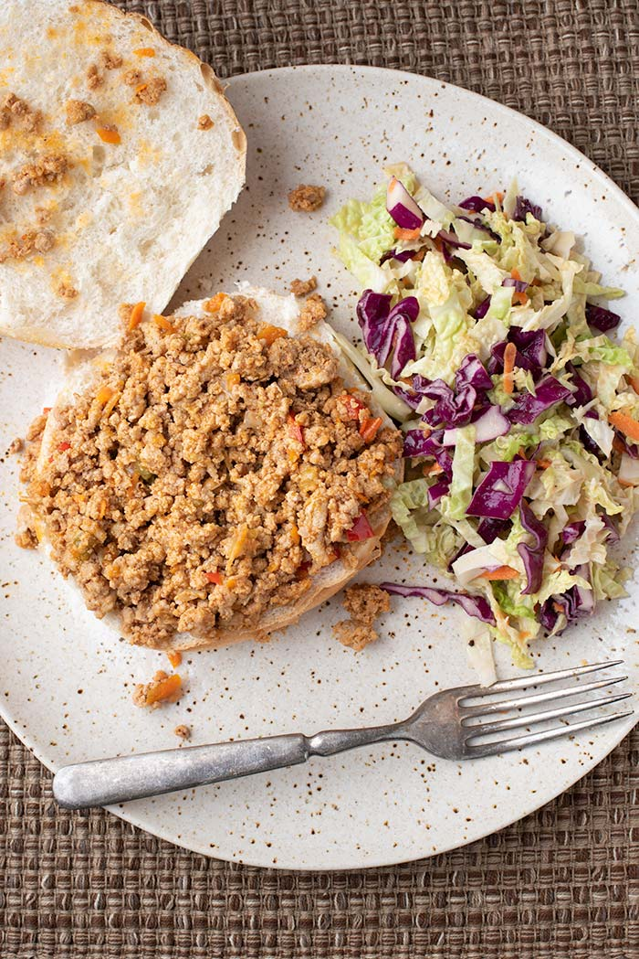 Instant Pot Sloppy Joes served with a side of cole slaw